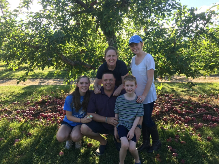 Paul Dustin and Family in apple orchard