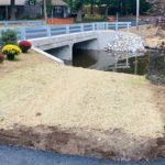 Completed culvert replacement photo with flowers