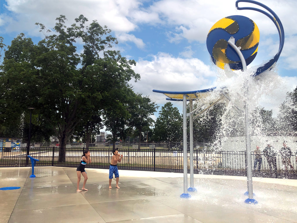 Image of children playing in splash pad at city park