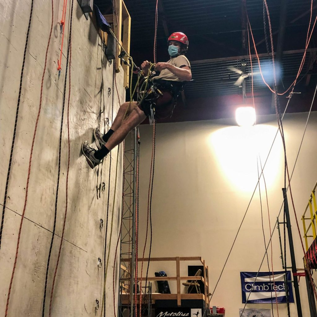 Ben Schorn, EIT climbing concrete wall with ropes for SPRAT certification
